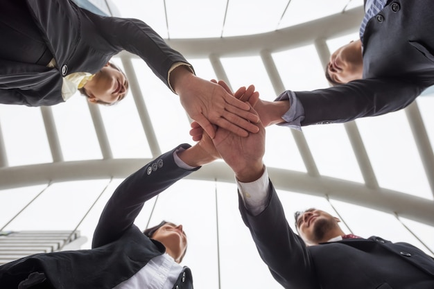Business team gather hands in city