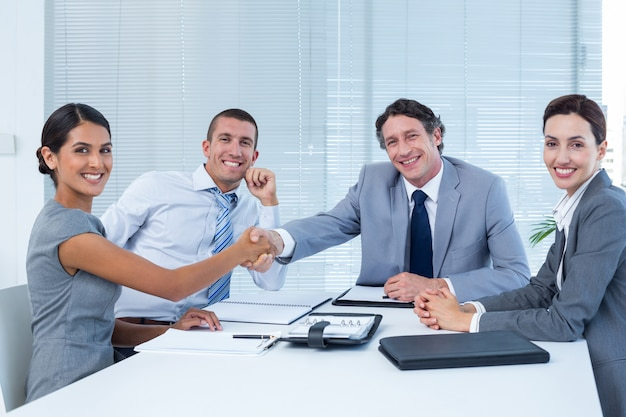 Business team greeting each other