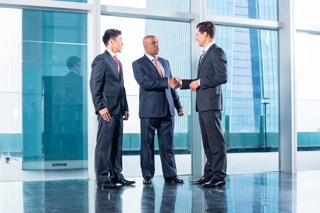 Business team having agreement and handshake