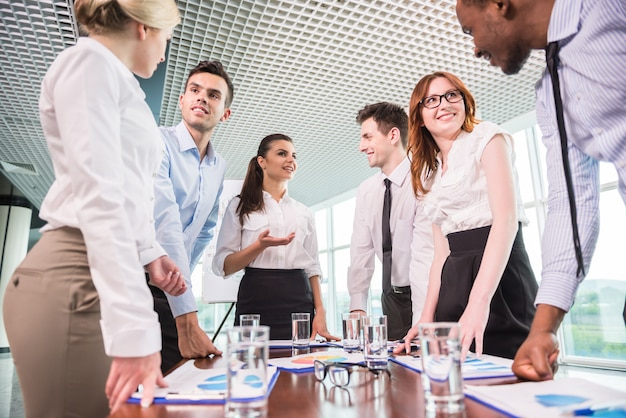 Business team at a meeting in a modern office environment.