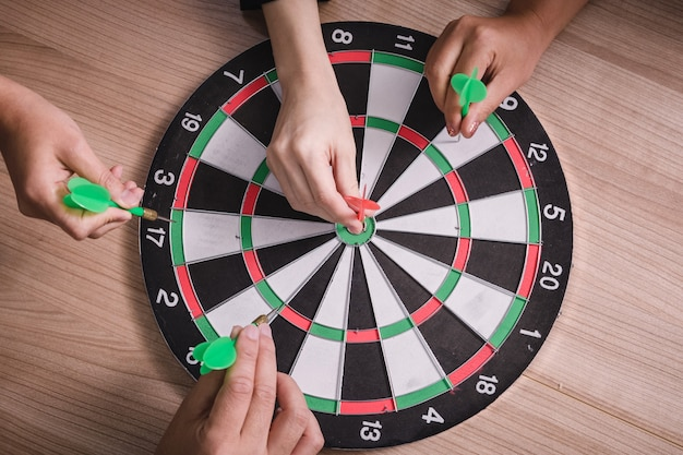 Business team pointing to a darts aiming at the target center business,targeting the business concept