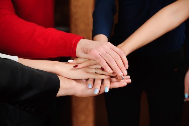Business team stack hands