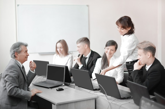 Business team working on laptops in a modern office