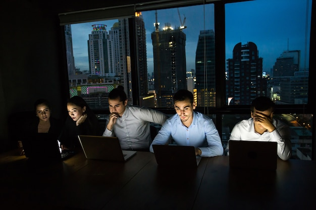 Business team working late at night