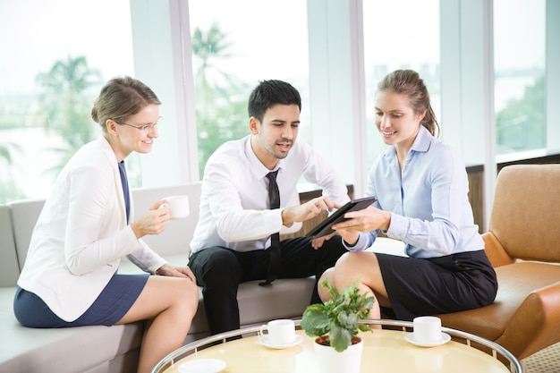 Business team working on tablet computer