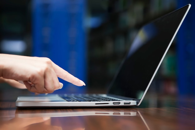 Business and technology concept. closeup of hand working with laptop on table.