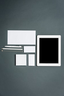 Business template with cards, papers, tablet. gray space.
