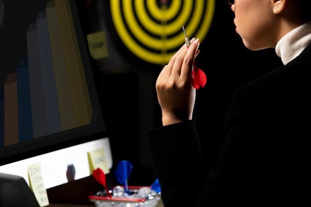 Business tomboy set dartboard as top target