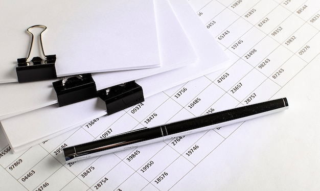 Business view -chart ,pen and papers on white table, concept