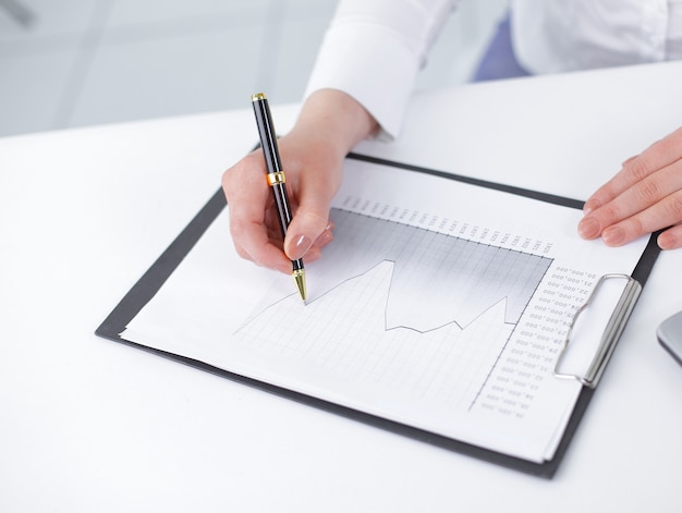 Business woman analyzing the financial schedule. photo with copy space