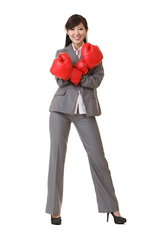Business woman of asian with red boxing gloves