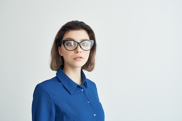 Business woman in blue shirt and glasses walkie-talkie office manager. high quality photo