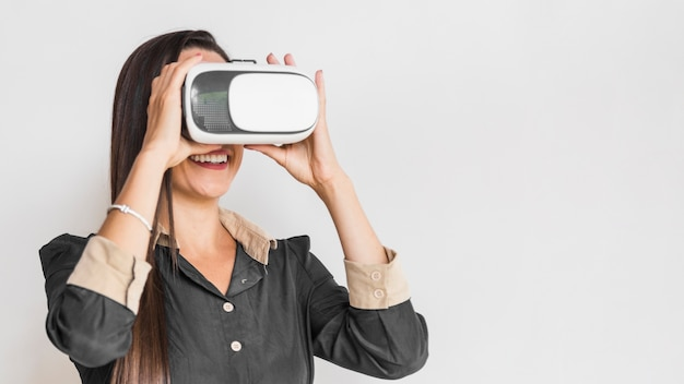Business woman checking vr glasses with copy space
