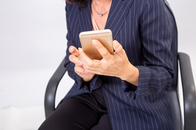 Business woman checks her emails on her mobile cell phone device smartphone