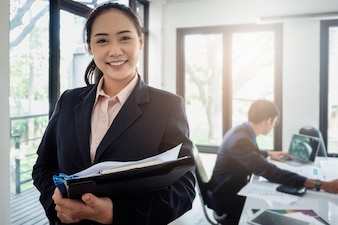Business woman consultant and businessman working at background in office