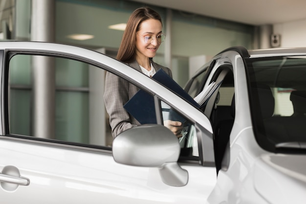 Business woman entering into a car