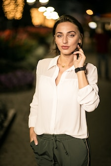 Business woman in the evening street