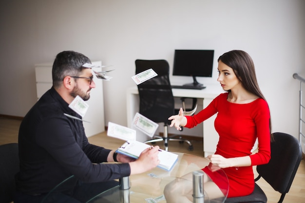 Business woman gives money to man