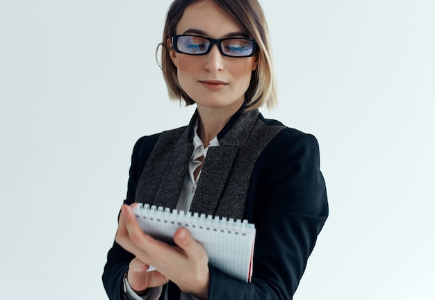 Business woman in glasses with notepad documents office