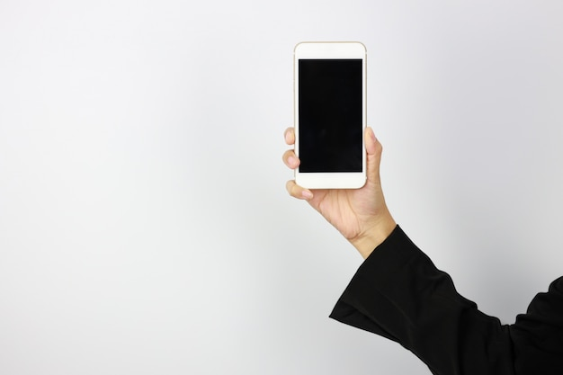 Business woman hand in black business suit uniform holding and showing mobile phone with black black screen