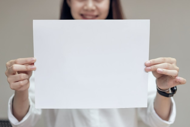 Business woman hold blank white card. for text banner.