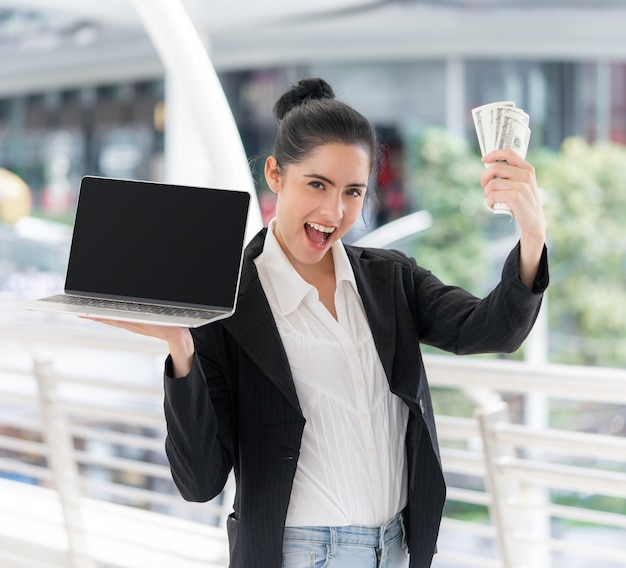 Business woman holding blank laptop