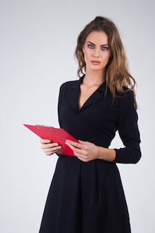 Business woman holding a clipboard, isolated business person