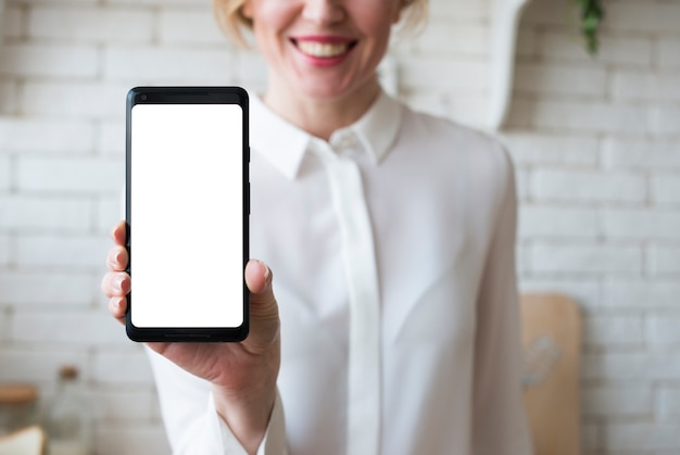 Business woman holding smartphone with blank screen