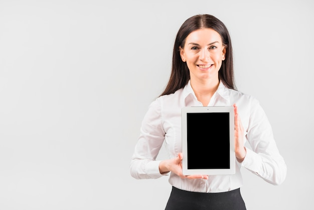 Business woman holding tablet with blank screen