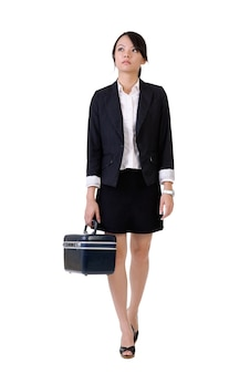 Business woman holding tools box and walking, full length portrait isolated over white.