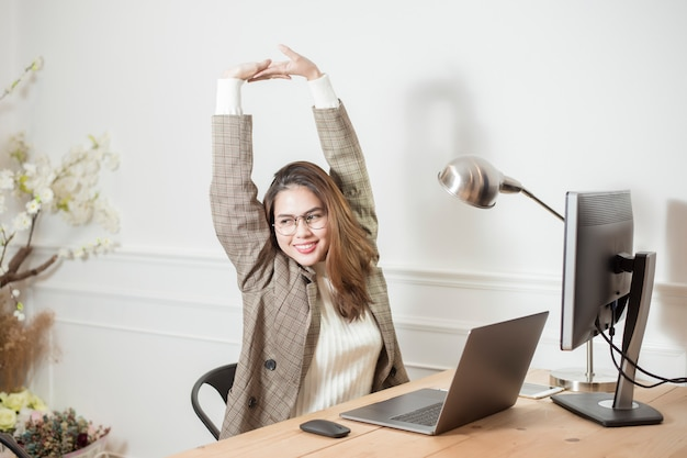 Business woman is working in her office desk