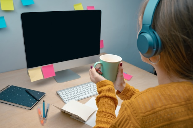Business woman near computer on her office morning at a creative studio graphic design mock up