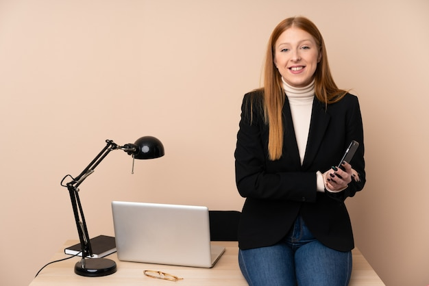 Business woman in a office laughing