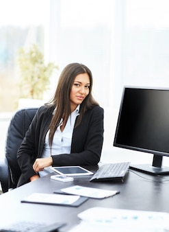 Business woman in office working with tablet