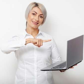 Business woman pointing at laptop