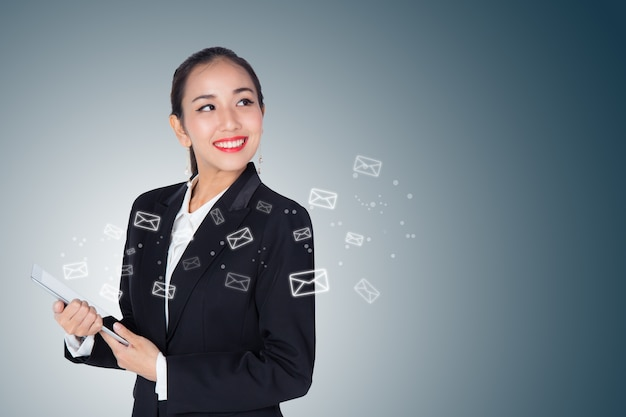 Business woman receive and sending email by digital tablet on blue background.