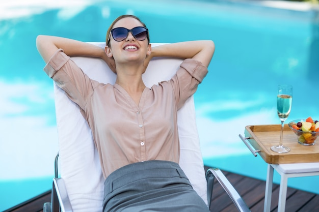 Business woman relaxing on sun lounger