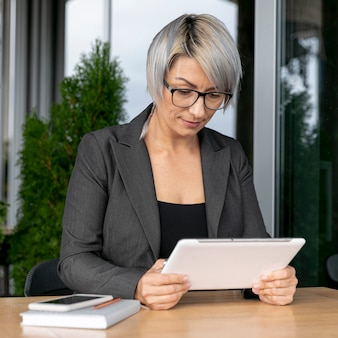 Business woman riding fron tablet mock up