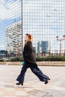 Business woman running on street