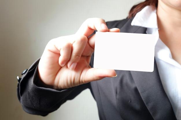 Business woman showing business card , business idea concept