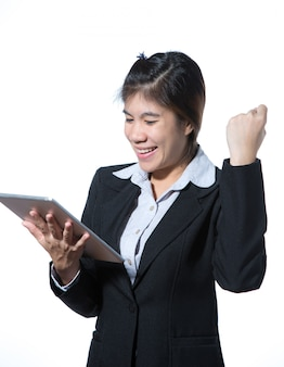 Business woman showing fighting hand holding computer tablet , business concept of success
