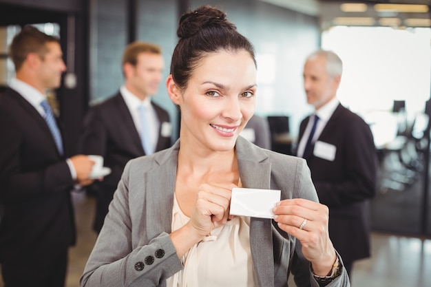 Business woman showing her badge