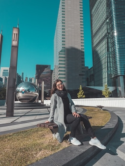 Business woman sit on the bench in seoul