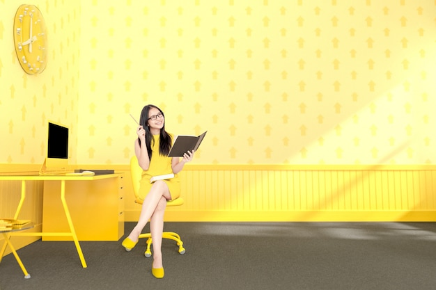 Business woman sitting at the desk yellow
