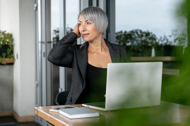 Business woman sitting and looking away