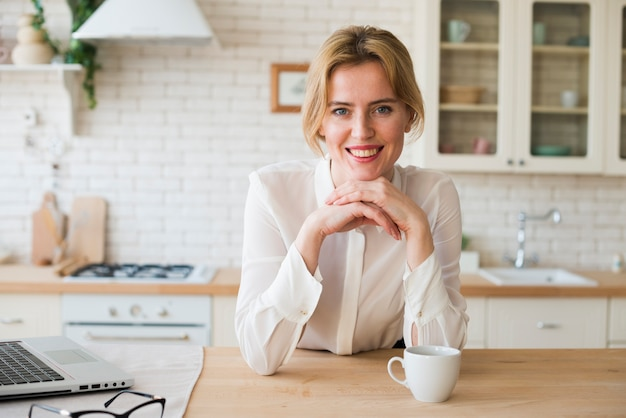 Business woman sitting with coffee cup and laptop