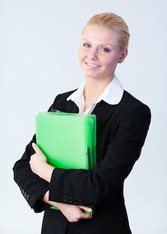 Business woman standing holding a folder