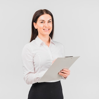 Business woman standing with clipboard