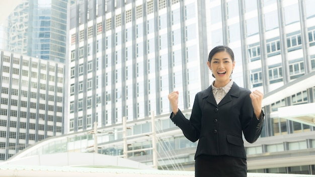 Business woman stands with confident at outdoor city