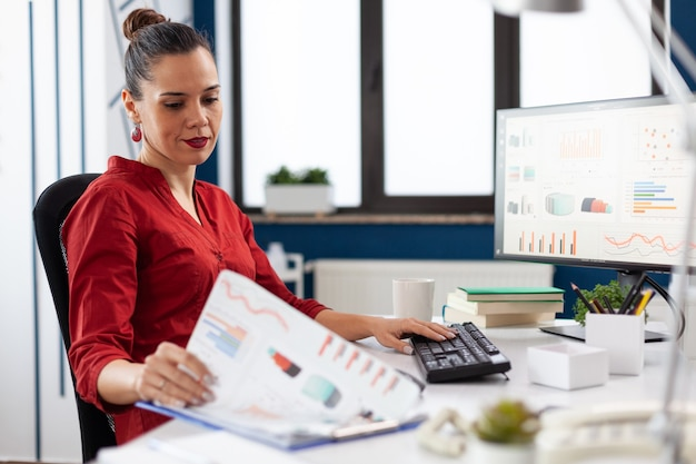 Business woman in start up company working on computer
